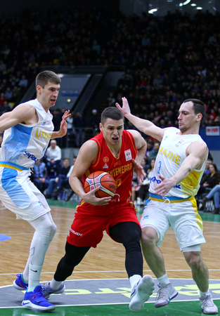 KYIV, UKRAINE - FEBRUARY 22,2019: Petar Popovic of Montenegro (C) attacks during the FIBA World Cup 2019 European Qualifiers game Ukraine v Montenegro at Palace of Sports in Kyiv. Montenegro won 76-74