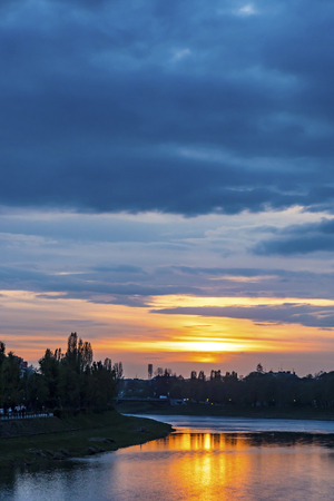 Sunset over Uzh river in Uzhhorod city, Transcarpathia region, Ukraine. Beautiful cityscape of old european town