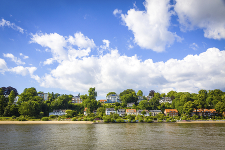Hamburg, Germany - June 25, 2014: Summer view of the beach (Strand Oevelgoenne) on the Elbe river in Oevelgoenne district of Hamburg city. Popular place by many Hamburgers and tourists Standard-Bild - 120826368
