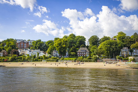 Hamburg, Germany - June 25, 2014: Summer view of the beach (Strand Oevelgoenne) on the Elbe river in Oevelgoenne district of Hamburg city. Popular place by many Hamburgers and tourists Standard-Bild - 120826369