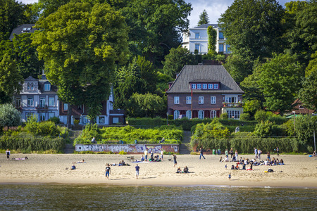 Hamburg, Germany - June 25, 2014: Summer view of the beach (Strand Oevelgoenne) on the Elbe river in Oevelgoenne district of Hamburg city. Popular place by many Hamburgers and tourists Standard-Bild - 120826370