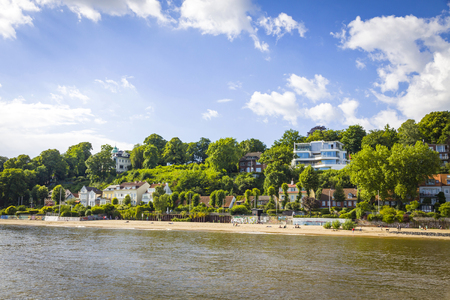 Hamburg, Germany - June 25, 2014: Summer view of the beach (Strand Oevelgoenne) on the Elbe river in Oevelgoenne district of Hamburg city. Popular place by many Hamburgers and tourists Standard-Bild - 120826371