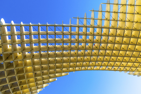 Seville, Spain - December 15, 2017: The Metropol Parasol (Setas de Sevilla), structure in shape of a pergola made of wood and concrete located at La Encarnacion square in Seville old town, Spain