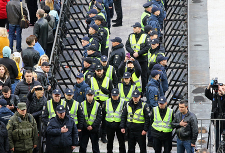 Kyiv, Ukraine - April 19, 2019: Policemen and securities listen to the national anthem during the Presidential Debate at NSC Olimpiyskiy stadium in Kyiv Standard-Bild - 122152044