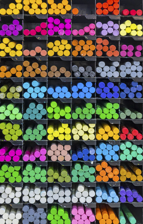 Colourful pieces of pastel chalks on the shelf