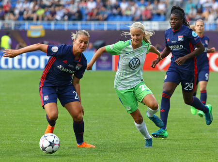 KYIV, UKRAINE - MAY 24, 2018: Amandine Henry of Olympique Lyonnais (L) fights for a ball with Pernille Harder of VFL Wolfsburg during their UEFA Womens Champions League Final 2018 game in Kyiv