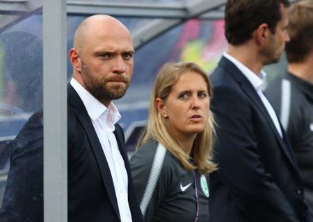 KYIV, UKRAINE - MAY 24, 2018: Stephan Lerch (L), head coach of VFL Wolfsburg team during the UEFA Women's Champions League Final 2018 game against Olympique Lyonnais at Lobanovskiy Stadium in Kyiv