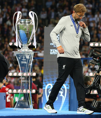 KYIV, UKRAINE - MAY 26, 2018: Liverpool manager Jurgen Klopp goes past the pedestal with Champions League Trophy (Cup) at Medal Ceremony after the UEFA Champions League Final 2018 game in Kyiv