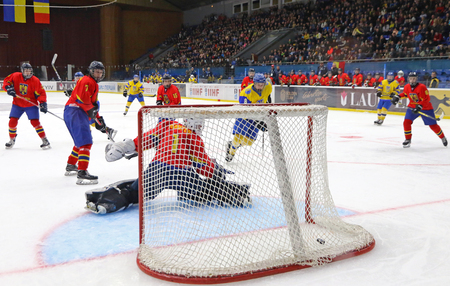 KYIV, UKRAINE - APRIL 20, 2018: Goalkeeper Arnold DEMETER of Romania missed a goal during the IIHF 2018 Ice Hockey U18 World Championship Div 1 Group B game against Ukraine. Romania lost 0-6