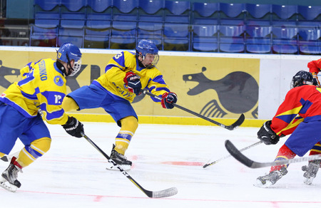 KYIV, UKRAINE - APRIL 20, 2018: Dmytro DANYLENKO of Ukraine shots a puck during the IIHF 2018 Ice Hockey U18 World Championship Div 1B game against Romania at Palace of Sports in Kyiv. Ukraine won 6-0