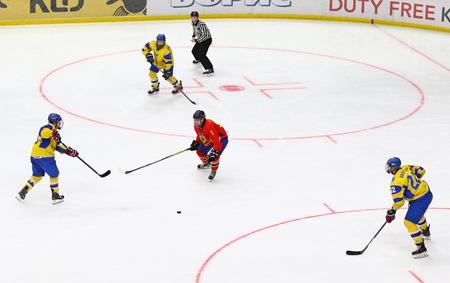 KYIV, UKRAINE - APRIL 20, 2018: IIHF 2018 Ice Hockey U18 World Championship Div 1 Group B game Ukraine (Yellow jersey) v Romania (Red jersey) at Palace of Sports in Kyiv, Ukraine. Ukraine won 6-0 Editorial
