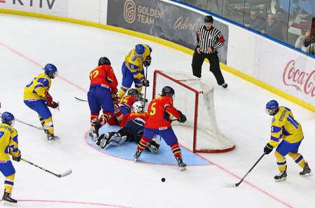 KYIV, UKRAINE - APRIL 20, 2018: Ukrainian players (in yellow) score a goal during the IIHF 2018 Ice Hockey U18 World Championship Div 1B game against Romania at Palace of Sports. Ukraine won 6-0 Editorial
