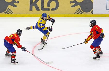KYIV, UKRAINE - APRIL 20, 2018: Olexander PERESUNKO of Ukraine shots a puck during the IIHF 2018 Ice Hockey U18 World Championship Div 1B game against Romania at Palace of Sports. Ukraine won 6-0