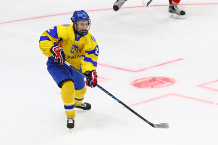 KYIV, UKRAINE - APRIL 20, 2018: Kyrylo BUDKO of Ukraine in action during the IIHF 2018 Ice Hockey U18 World Championship Div 1B game against Romania at Palace of Sports in Kyiv. Ukraine won 6-0