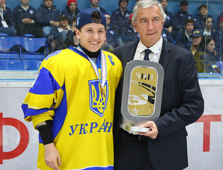 KYIV, UKRAINE - APRIL 20, 2018: Artem MATEICHENKO, captain of Ukraine team with gold award of the IIHF 2018 Ice Hockey U18 World Championship Div 1B at Palace of Sports in Kyiv 에디토리얼