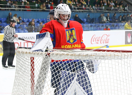 KYIV, UKRAINE - APRIL 20, 2018: Goalkeeper Arnold DEMETER of Romania in action during the IIHF 2018 Ice Hockey U18 World Championship Div 1 Group B game against Ukraine at Palace of Sports in Kyiv