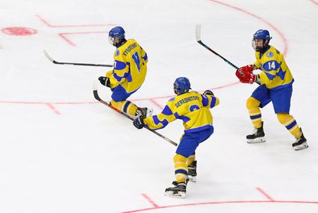 KYIV, UKRAINE - APRIL 20, 2018: Players of Ukraine National Team react after scored a goal during the IIHF 2018 Ice Hockey U18 World Championship Div 1B game against Romania. Ukraine won 6-0