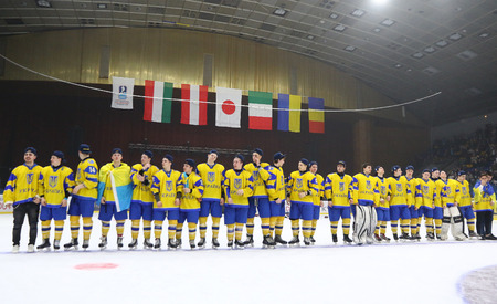 KYIV, UKRAINE - APRIL 20, 2018: Players of Ukraine National Team listen to national anthem after the IIHF 2018 Ice Hockey U18 World Championship Div 1B game against Romania at Palace of Sports