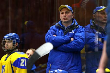 KYIV, UKRAINE - APRIL 20, 2018: Head Coach Oleg IGNATYEV of Ukraine looks on during IIHF 2018 Ice Hockey U18 World Championship Div 1B game against Romania at Palace of Sports in Kyiv. Ukraine won 6-0