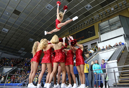 KYIV, UKRAINE - APRIL 20, 2018: Cheerleaders team Red Foxes perform during the IIHF 2018 Ice Hockey U18 World Championship Div 1B game Ukraine v Romania at Palace of Sports in Kyiv. Ukraine won 6-0