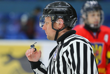 KYIV, UKRAINE - APRIL 20, 2018: Ice-hockey referee in action during the IIHF 2018 Ice Hockey U18 World Championship Div 1B game Ukraine v Romania at Palace of Sports in Kyiv