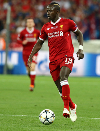 KYIV, UKRAINE - MAY 26, 2018: Sadio Mane of Liverpool controls a ball during the UEFA Champions League Final 2018 game against Real Madrid at NSC Olimpiyskiy Stadium in Kyiv. Liverpool lost 1-3 에디토리얼