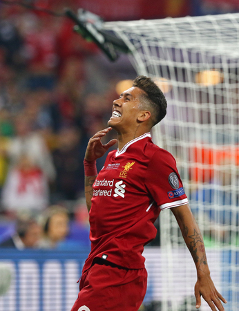 KYIV, UKRAINE - MAY 26, 2018: Roberto Firmino of Liverpool runs during the UEFA Champions League Final 2018 game against Real Madrid at NSC Olimpiyskiy Stadium in Kyiv. Liverpool lost 1-3