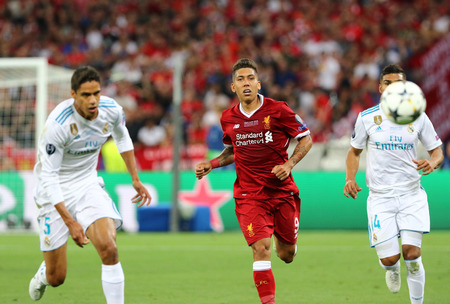 KYIV, UKRAINE - MAY 26, 2018: Roberto Firmino of Liverpool (C) runs during the UEFA Champions League Final 2018 game against Real Madrid at NSC Olimpiyskiy Stadium in Kyiv. Liverpool lost 1-3