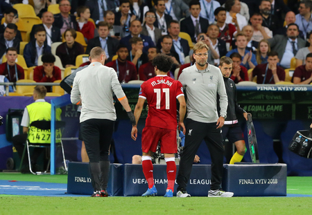 KYIV, UKRAINE - MAY 26, 2018: Substitution of Mohamed Salah (Liverpool) after he had been injured by Sergio Ramos (Real Madrid) during the UEFA Champions League Final 2018 game Liverpool v Real Madrid
