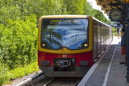 Berlin, Germany - July 1, 2014: S-Bahn train arrives at the eastern Yorckstrasse S-Bahn station in Berlin. Station opened in 1903. Located in the Schoneberg locality of central Berlin, Germany