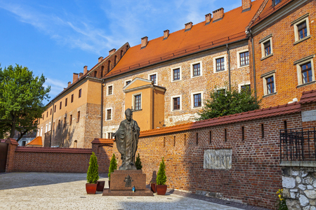 Krakow, Poland - July 8,2014: Monument of Pope John Paul II (John Paul the Great Papa Giovanni Paolo II Karol Jozef Wojtyla) located in Wawel Royal Castle. Created by Gustaw Zemla, unveiled in 2008