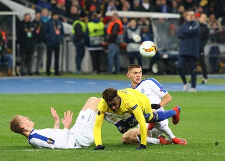 KYIV, UKRAINE - MARCH 14, 2019: UEFA Europa League game FC Dynamo Kyiv v Chelsea at NSC Olimpiyskyi stadium in Kyiv. Mykyta Burda (L), V.Mykolenko (R) of Dynamo Kyiv and Callum Hudson-Odoi of Chelsea