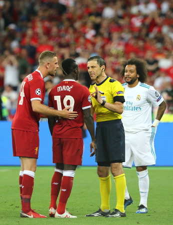 KYIV, UKRAINE - MAY 26, 2018: Liverpool players Jordan Henderson and Sadio Mane talk to referee Milorad Mazic during the UEFA Champions League Final 2018 game Liverpool v Real Madrid