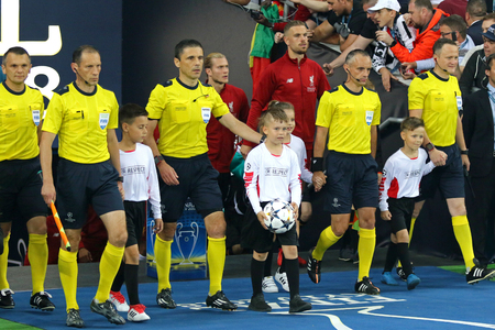 KYIV, UKRAINE - MAY 26, 2018: Referees and players go to the pitch of NSC Olimpiyskiy Stadium in Kyiv before the UEFA Champions League Final 2018 game Liverpool v Real Madrid Editorial