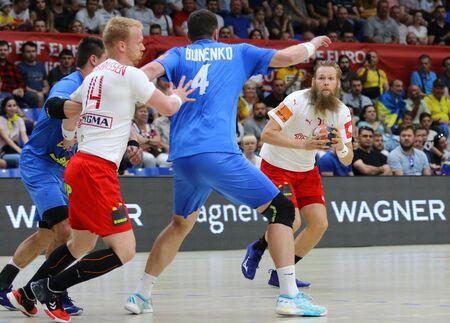 KYIV, UKRAINE - JUNE 12, 2019: Nikolaj Oris NIELSEN of Denmark (R) attacks during the EHF EURO 2020 Qualifiers handball game Ukraine v Denmark at Palace of Sports in Kyiv. Denmark won 33-30