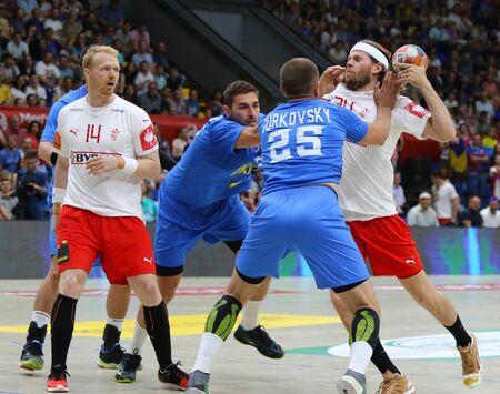 KYIV, UKRAINE - JUNE 12, 2019: Mikkel HANSEN of Denmark (R) attacks during the EHF EURO 2020 Qualifiers handball game Ukraine v Denmark at Palace of Sports in Kyiv. Denmark won 33-30. HANSEN scored 7