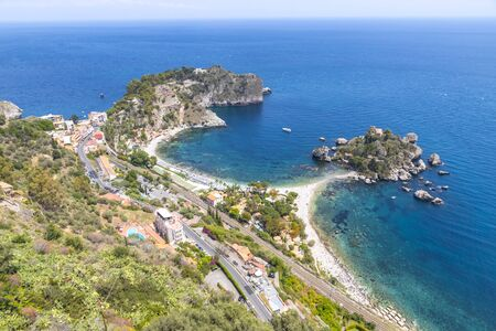 Aerial view of Isola Bella island and beach in Taormina, Sicily, Italy