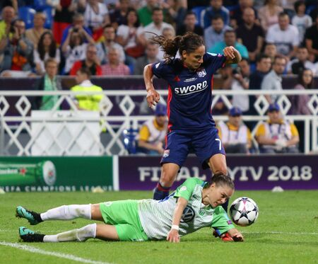 KYIV, UKRAINE - MAY 24, 2018: Amel Majri of Olympique Lyonnais (Up) fights for a ball with Ewa Pajor of VFL Wolfsburg during their UEFA Women's Champions League Final 2018 game in Kyiv Editorial
