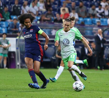 KYIV, UKRAINE - MAY 24, 2018: Wendie Renard of Olympique Lyonnais (L) fights for a ball with Ewa Pajor of VFL Wolfsburg during their UEFA Women's Champions League Final 2018 game in Kyiv Editorial