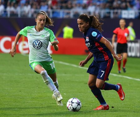 KYIV, UKRAINE - MAY 24, 2018: Amel Majri of Olympique Lyonnais (R) fights for a ball with Tessa Wullaert of VFL Wolfsburg during their UEFA Womens Champions League Final 2018 game in Kyiv