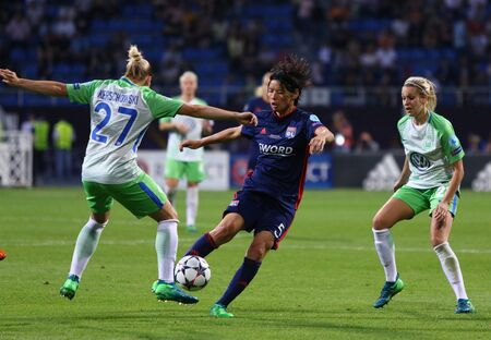 KYIV, UKRAINE - MAY 24, 2018: Saki Kumagai of Olympique Lyonnais (C) fights for a ball with Isabel Kerschowski of VFL Wolfsburg during their UEFA Women's Champions League Final 2018 game in Kyiv