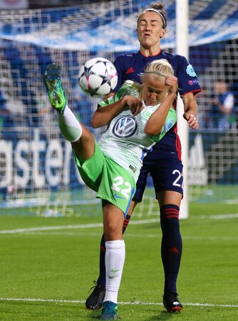 KYIV, UKRAINE - MAY 24, 2018: Pernille Harder of VFL Wolfsburg (L) fights for a ball with Lucy Bronze of Olympique Lyonnais during their UEFA Women's Champions League Final 2018 game in Kyiv