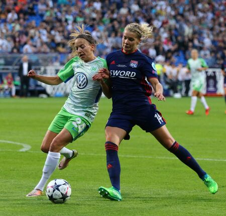 KYIV, UKRAINE - MAY 24, 2018: Joelle Wedemeyer of VFL Wolfsburg fights for a ball with Ada Hegerberg of Olympique Lyonnais during their UEFA Women's Champions League Final 2018 game in Kyiv Editorial