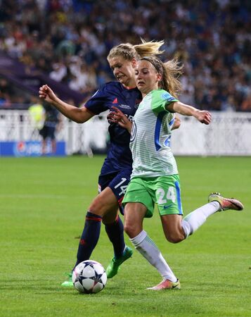 KYIV, UKRAINE - MAY 24, 2018: Ada Hegerberg of Olympique Lyonnais (L) fights for a ball with Joelle Wedemeyer of VFL Wolfsburg during their UEFA Women's Champions League Final 2018 game in Kyiv Editorial
