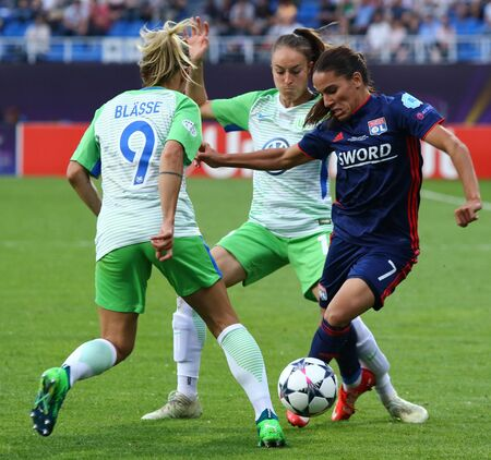 KYIV, UKRAINE - MAY 24, 2018: Amel Majri of Olympique Lyonnais (R) fights for a ball with Anna Blasse and Tessa Wullaert of VFL Wolfsburg during their UEFA Women's Champions League Final 2018 game Editorial