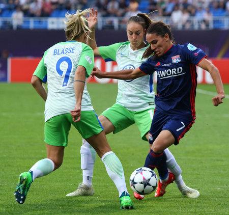 KYIV, UKRAINE - MAY 24, 2018: Amel Majri of Olympique Lyonnais (R) fights for a ball with Anna Blasse and Tessa Wullaert of VFL Wolfsburg during their UEFA Womens Champions League Final 2018 game Editöryel