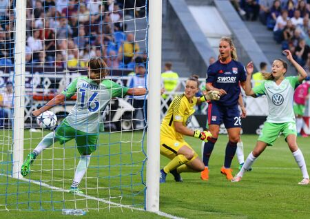 KYIV, UKRAINE - MAY 24, 2018: VFL Wolfsburg players (in Green) defend their net during the UEFA Women's Champions League Final 2018 game against Olympique Lyonnais at V.Lobanovskiy Stadium in Kyiv