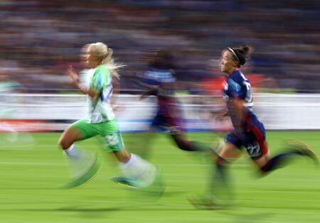 KYIV, UKRAINE - MAY 24, 2018: Pernille Harder of VFL Wolfsburg (L), Griedge MBock Bathy (C) and Lucy Bronze (both of Olympique Lyonnais) run during their UEFA Women's Champions League Final 2018 game