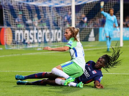 KYIV, UKRAINE - MAY 24, 2018: Delphine Cascarino of Olympique Lyonnais (L) fights for a ball with Noelle Maritz of VFL Wolfsburg during their UEFA Women's Champions League Final 2018 game in Kyiv