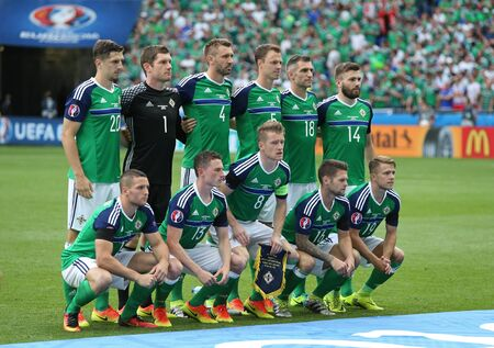 LYON, FRANCE - JUNE 16, 2016: Players of Northern Ireland national football team pose for a group photo before UEFA EURO 2016 game against Ukraine at Stade de Lyon stadium in Lyon 報道画像